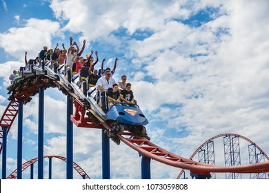 WOODMORE, MD/USA - SEPTEMBER 13, 2015:  Thrillseekers ride one of the roller coasters at Six Flags Amusement Park in Maryland.