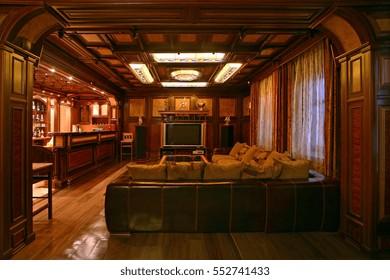 Wood-paneled living room.