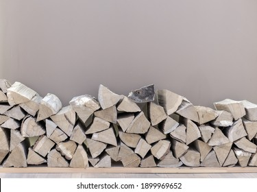 Woodpile of birch firewood for lighting a fireplace, stove or fire.