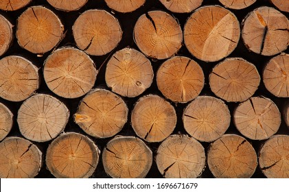 woodpile, firewood, interior decoration with wood, construction of wood, baths, saunas, firewood for the fireplace and stove. The concept of using natural materials.