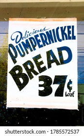 Woodridge, NY / USA - 06/16/2020: Vintage Grocery Store Sign Delicious Pumpernickel Bread 37 Cents Loaf circa 1950's, 1960's