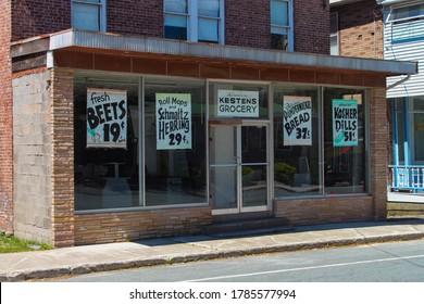 Woodridge, NY / USA - 06/16/2020: Vintage Kesten's Grocery Store Front with Vintage Signs in Windows, circa 1950's, 1960s Small Local Business