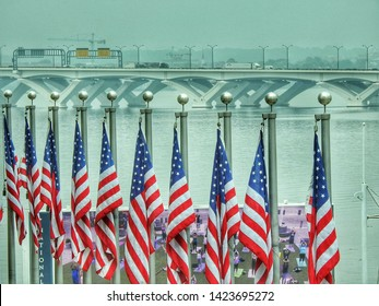 Woodrow Wilson Bridge And United States Flags Over The Potomac River In Maryland USA