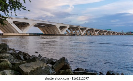 The Woodrow Wilson Memorial Bridge spans the Potomac River between Alexandria, Virginia, and the state of Maryland.