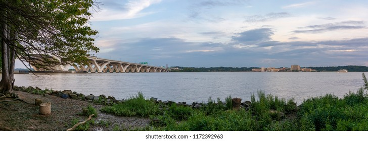 The Woodrow Wilson Memorial Bridge spans the Potomac River between Alexandria, Virginia, and the state of Maryland, as seen from Jones Point Park in Alexandria.