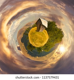 woodshed on little planet spherical panorama at sunset. beautiful countryside concept with 360 degree view. abandoned building on a meadow among the forest in summer mountains