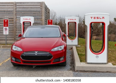 WOODSTOCK, CANADA - April 16th, 2019: Front of Tesla Model S while parked and charging at Tesla Supercharger.