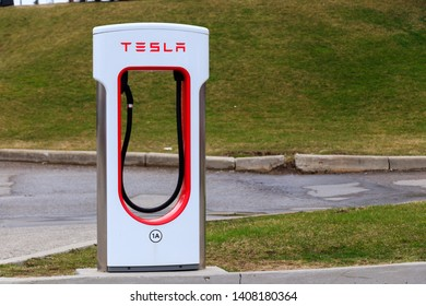 WOODSTOCK, CANADA - April 16th, 2019: Tesla Supercharger Stall.