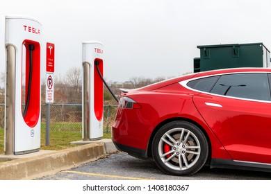 WOODSTOCK, CANADA - April 16th, 2019: Closeup of Tesla Model S supercharging at Tesla Supercharger location.