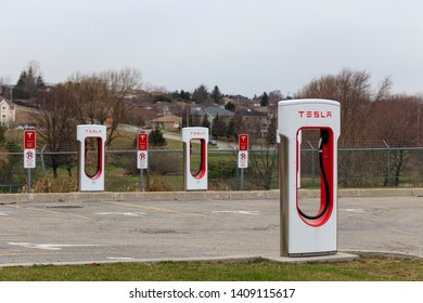 WOODSTOCK, CANADA - April 16th, 2019: Tesla Supercharger Stall at Woodstock, Ontario Station.