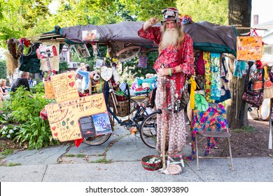 WOODSTOCK, NY - AUGUST 30, 2015: Hippie Allyn Richardson, also known as Grandpa Woodstock, poses for photograph outside tent sale in Woodstock New York.