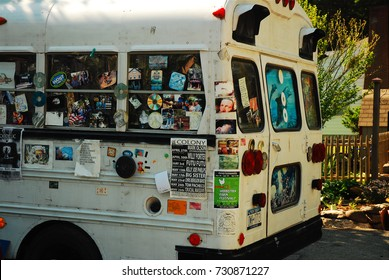 Woodstock, NY, USA June 1, 2008 A former school bus is layered with bumper stickers at an alternative culture store in Woodstock, New York