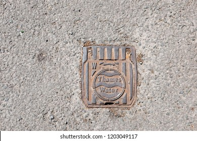 WOODSTOCK, UK - JUNE 21, 2018: Facade of Thames Water valve manhole cover in Woodstock, England. Thames Water Utilities Ltd is the monopoly supplying water and waste treatment in Thames Valley.
