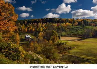 Woodstock, Vermont, United States - October 11, 2014: Morning light on Sleepy Hollow Farm on Cloudland Road Woodstock Vermont with Fall colors