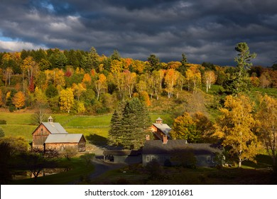 Woodstock, Vermont, United States - October 11, 2014: Evening sun on Sleepy Hollow Farm Cloudland Road Woodstock Vermont in the Fall with dark clouds