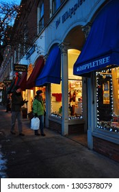 Woodstock, VT, USA December 17, 2009 Holiday shoppers check out the latest store windows in the downtown shopping district of Woodstock, Vermont