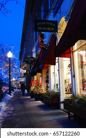 Woodstock, VT, USA December 17, 2009 The stores light up the sidewalks of a small New England town during the holiday shopping season