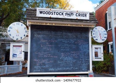 Woodstock, VT, USA October 10, 2012 The Woodstock Town Crier lists meetings and events on the community chalkboard in Woodstock, Vermont