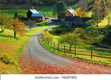 Woodstock, VT, USA October 10, 2010 a winding country road passes though a bucolic farm in autumn near Woodstock, Vermont