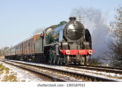 WOODTHORPE, LEICESTERSHIRE, UK - JANUARY 26, 2013: SR 'King Arthur' 4-6-0 No. 30777 'Sir Lamiel' powers towards Quorn and Woodhouse on the GCR, with the 2A11 11:15 Loughborough to Leicester North.
