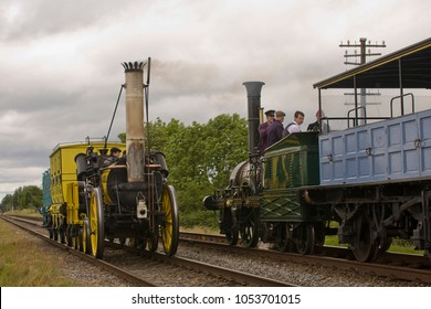 WOODTHORPE, LEICESTERSHIRE, UK - MAY 28, 2011: The NRM's steam locomotive  L&MR 0-2-2 Rocket (Replica) passes another vintage locomotive at Woodthorpe during the GCR's Golden Oldies Gala.