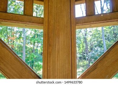 Woodwork corner frames of outdoor gazebo. Gazebo wood frame work.