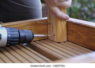 Woodwork putting in screws