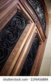Woodwork and wrought iron on a French mansion door