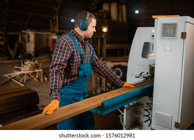 Woodworker works on machine, lumber industry