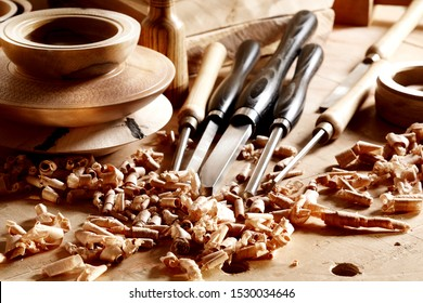 Woodworkers  shop. Woodturning project to making a handmade bowls. Woodturning tools and workpieces. Chisels and bowls.