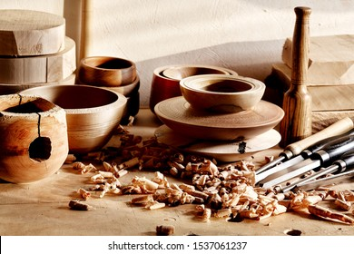 Woodworkers  shop. Woodturning project to making a handmade bowls. Woodturning tools and workpieces