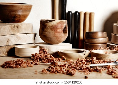 Woodworkers shop. Woodturning project. Making handmade wooden bowls. Turners tools and wooden bowls pieces on the workbench