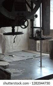 Woodworking bandsaw in shadow, workshop detail