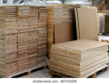 the woodworking factory, storage of treated wood,  stacks of wooden planks