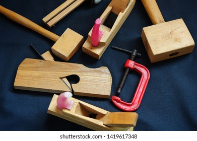 Woodworking. Joiner's works. Joiner's tools on dark background