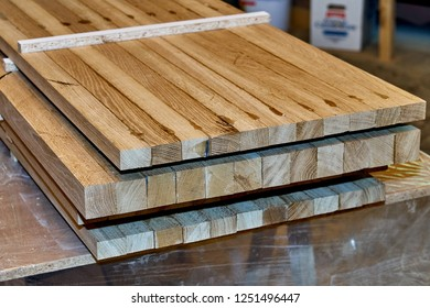 Woodworking and joinery production. Glued oak wood panels for wooden bed