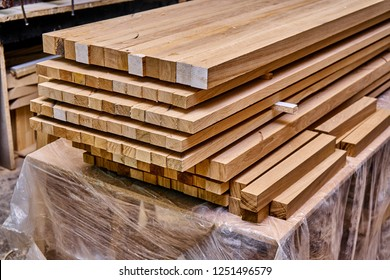 Woodworking and joinery production. Glued oak wood panels for wooden bed. Furniture manufacture
