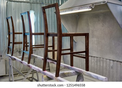 Woodworking and joinery production. Making wooden frame chairs. Painting chairs in the chamber. Furniture manufacture