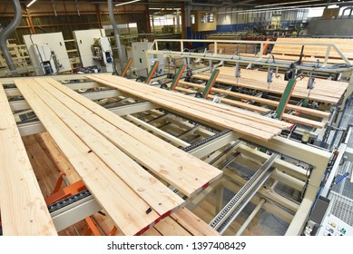 woodworking/ sawmill: production and processing of wooden boards in a modern industrial factory - assembly line in production