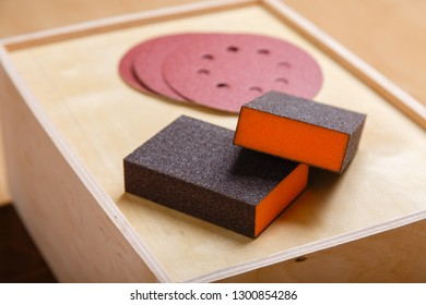 Woodworking tools. Sanding wood for smoothness. Carpenter tools. Emery sponge and emery wheels