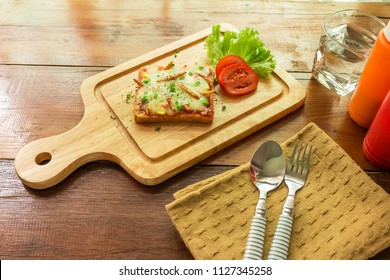 Woodworm, Edible insects with baked bread and mozzarella cheese on wooden cutting board. Insect food is the healthy meal high protein the popular food in Thailand. Selective focus