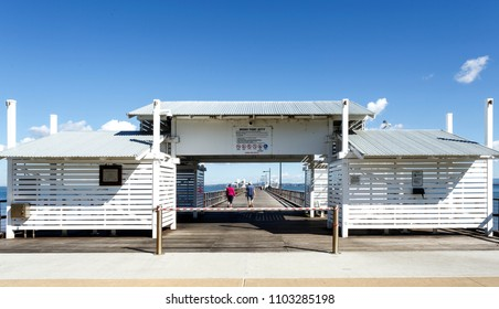 WOODY POINT, AUSTRALIA – May 30, 2018:  Entrance facade of the Woody Point Jetty, a 240 meters long pier in the Redcliffe Peninsula, Queensland, Australia