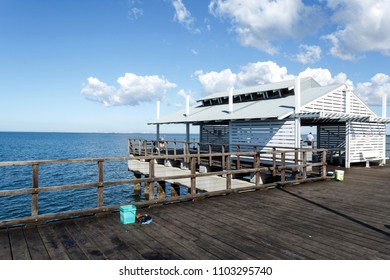 WOODY POINT, AUSTRALIA – May 30, 2018:  Detail view of the Woody Point Jetty, a popular recreational fishing spot in the Redcliffe Peninsula, Queensland, Australia