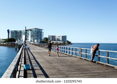 WOODY POINT, AUSTRALIA – May 30, 2018:  Panoramic view of the Woody Point Jetty, a 240 meters long pier in the Redcliffe Peninsula, Queensland, Australia