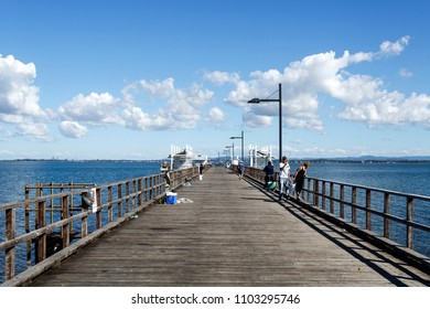 WOODY POINT, AUSTRALIA – May 30, 2018:  Panoramic view of the Woody Point Jetty, a popular recreational fishing spot in the Redcliffe Peninsula, Queensland, Australia