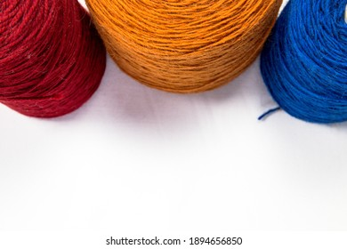 Wool in a ball on a white background, industrial wool for the production of carpets