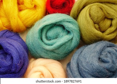 Wool of different colors for felting, felting needle, needlework