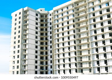 Wool insulated facade. Walls made of aerated concrete blocks. Window installation. Ventilated facade installing. Apartment building under construction. Concrete residential building