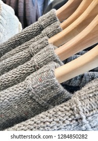 Wool jumpers hanging in a store