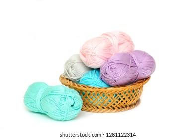 wool skeins in a wikcer basket